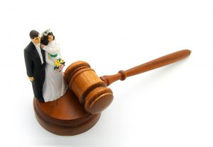 Bride and groom cake topper with gavel