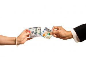Man and woman fighting over money.